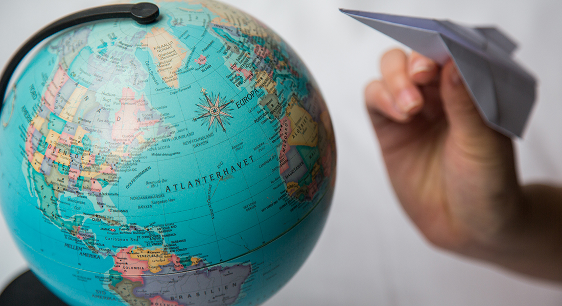 Decorative: Globe and paper plane